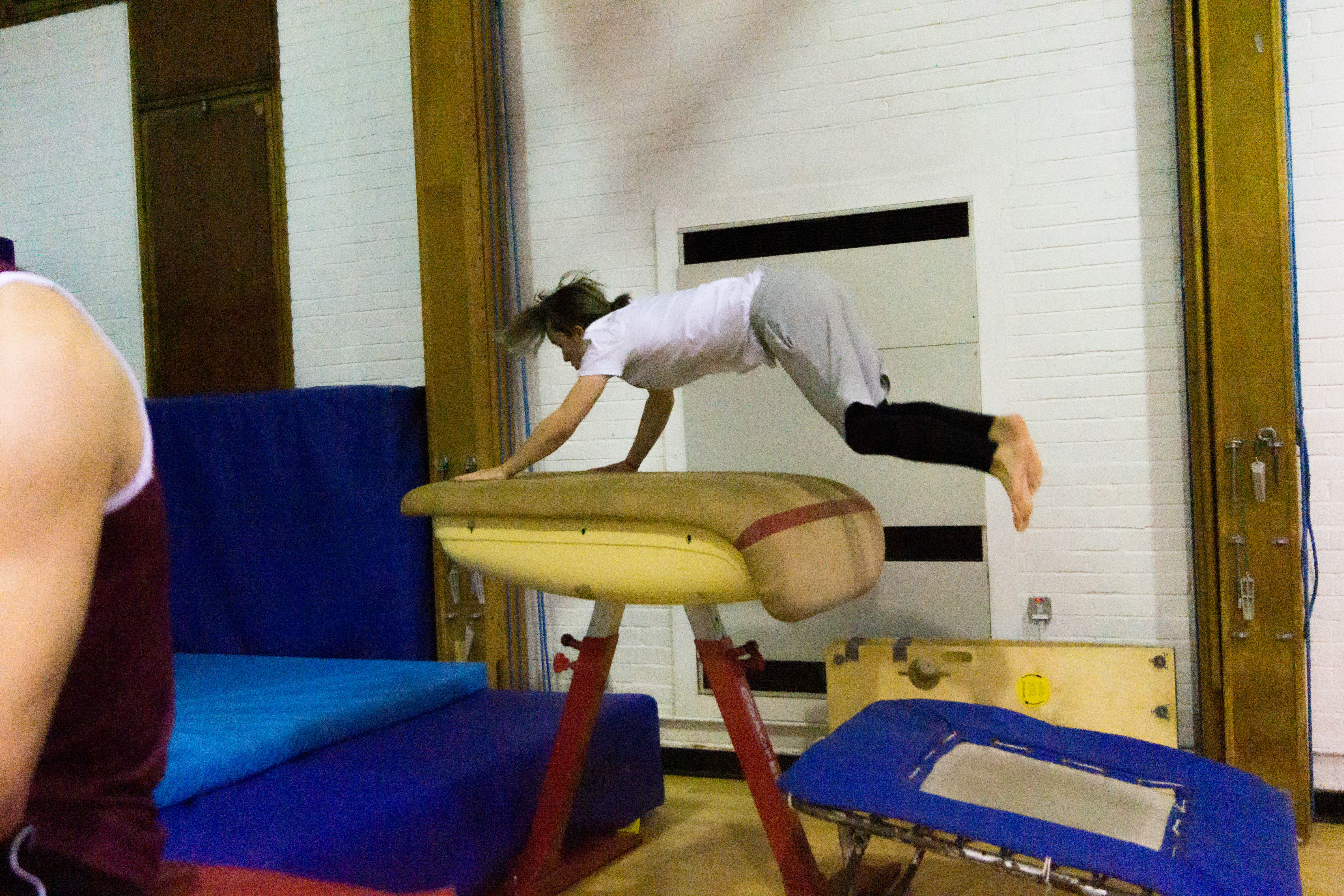 Gymnast performing a vault